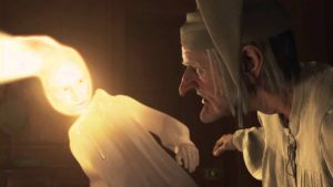 The ghost of Christmas past visits Ebenezer Scrooge in Disney's A Christmas Carol